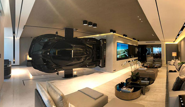 This man loves his $1.5M sports car so much, he hung it inside his Miami Beach condo
